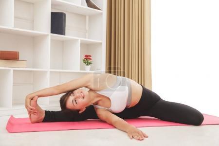flexible sporty girl doing yoga pose