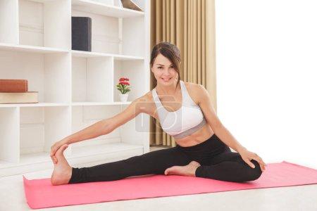 beautiful sporty girl doing leg stretching