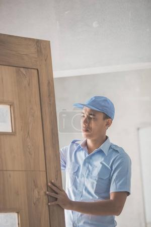 Worker installing doors