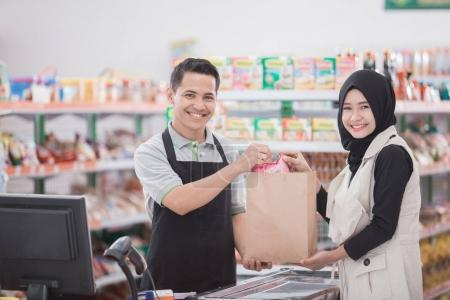 muslim woman buying product