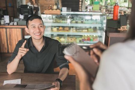 customer ordering food toward waitress
