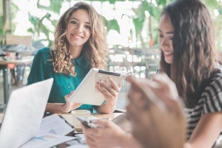 Women using gadgets