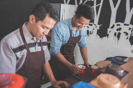 Two barista working