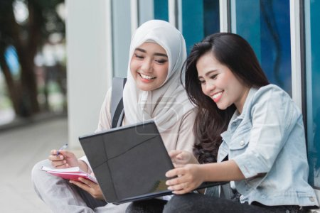 college students using laptop