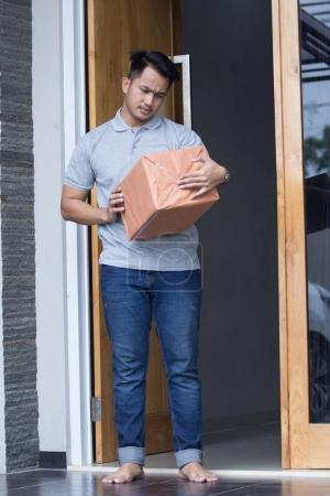 a man receiving a delivery box