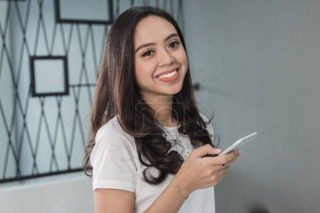 Pretty woman smiling with phone