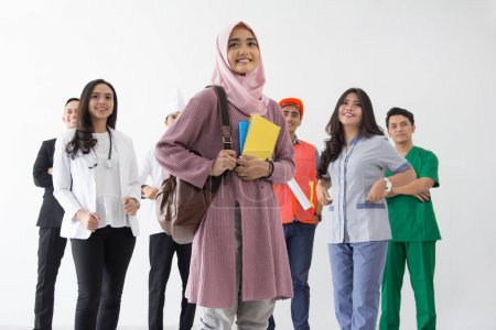 Photo for Young female student standing in background set of diverse occupation profession - Royalty Free Image