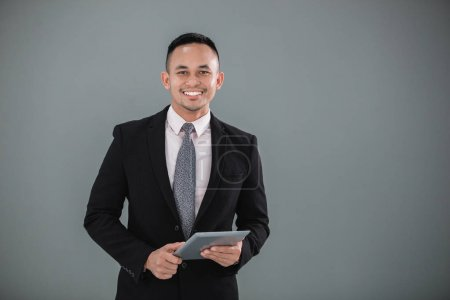 Young adult businessman with tablet