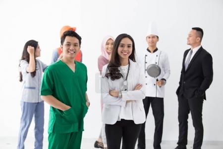 Photo for Doctor and nurse are standing in background set of diverse occupation profession - Royalty Free Image