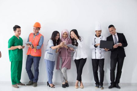 Photo for Portrait of various professions and occupation enjoying modern technology - Royalty Free Image