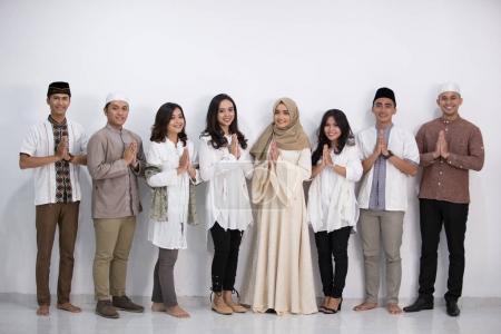 men and woman muslim eid mubarak