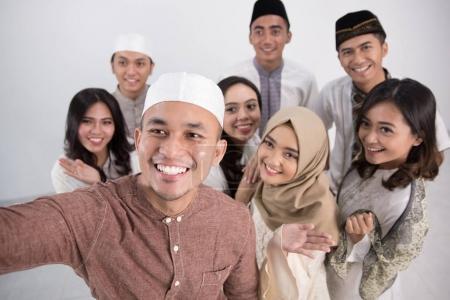 Group of men and woman asian muslim