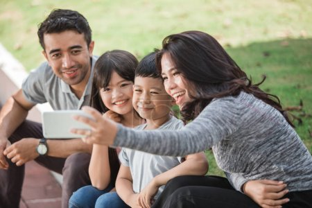 happy family taking selfie together