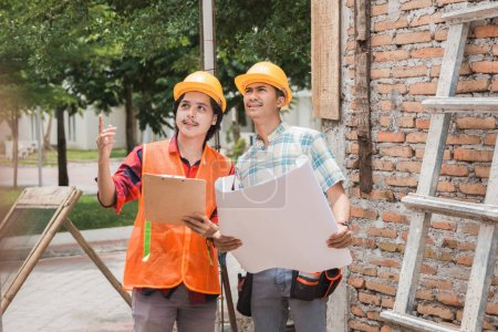two construction worker standing in the building site