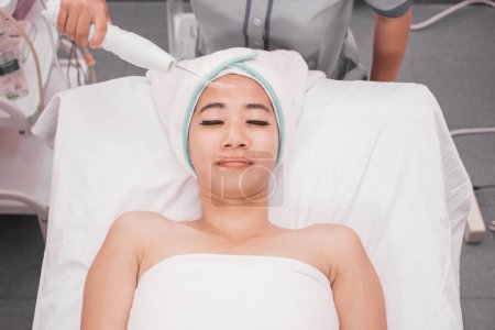 woman getting facial darsonval therapy