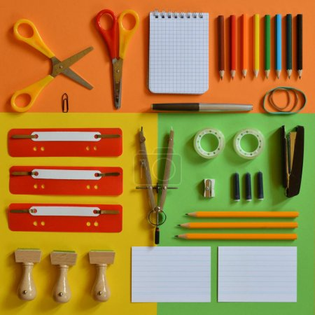 School supplies on colorful paperboard as square