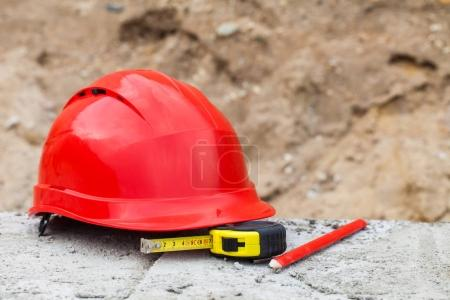 red helmet and tools