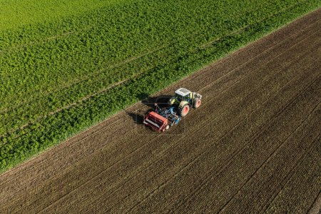 Photo for Aerial view of the tractor on the harvest field in Poland - Royalty Free Image