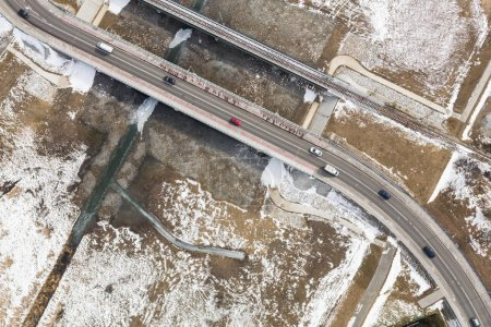 aerial view of road on bridge with cars