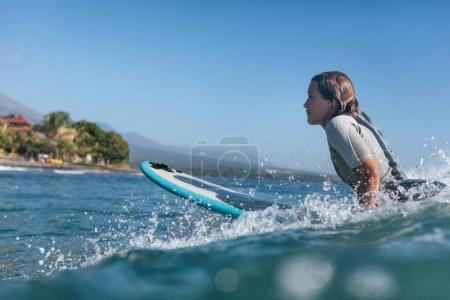 Photo for Surf woman surfing the wave in ocean - Royalty Free Image