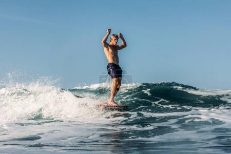 Photo for Active surfer having fun and riding wave in ocean - Royalty Free Image