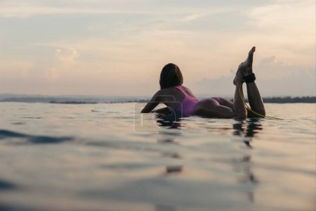 lying on surfboard