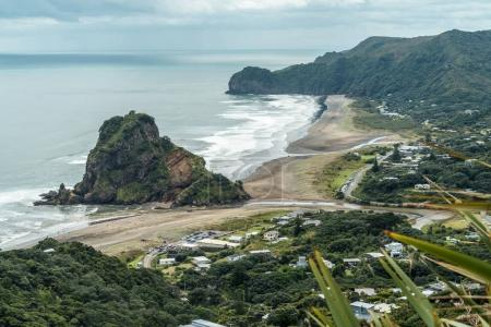 Photo for Aerial view of town on seashore on cloudy day, Piha beach, New Zealand - Royalty Free Image