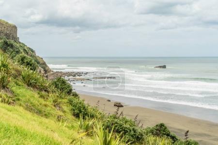 Photo for Dramatic shot of wavy ocean under cloudy sky, Muriwai beach, New Zealand - Royalty Free Image