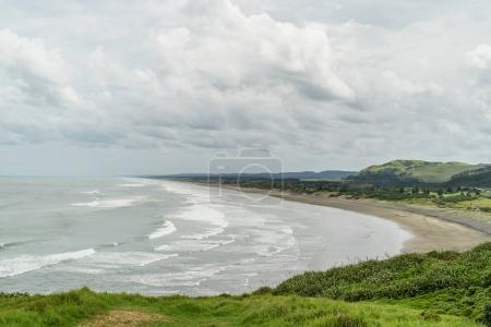 Photo for Scenic shot of stormy ocean and coastline, Muriwai beach, New Zealand - Royalty Free Image