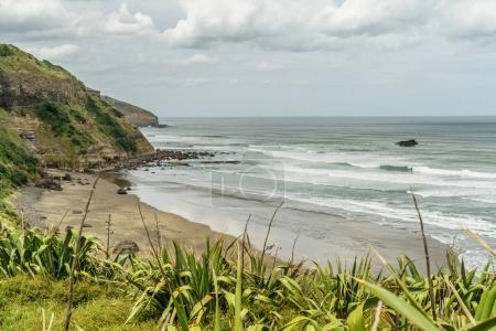 Photo for Dramatic shot of stormy ocean and coastline, Muriwai beach, New Zealand - Royalty Free Image