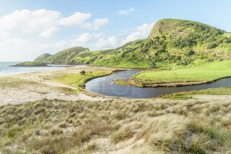 Photo for Scenic shot of green mountain with curvy river, Spirits Bay, New Zealand - Royalty Free Image