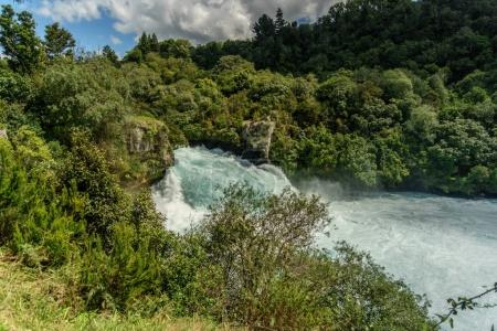 Photo for Scenic shot of beautiful waterfall in forest, Huka Falls, New Zealand - Royalty Free Image