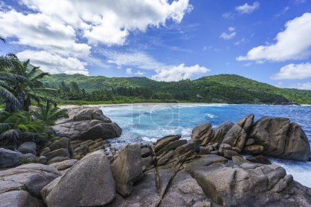 Photo for Big granite rocks, palm trees, turquoise water of the indian ocean, white sand at wild paradise tropical beach,police bay, seychelles , mahe - Royalty Free Image