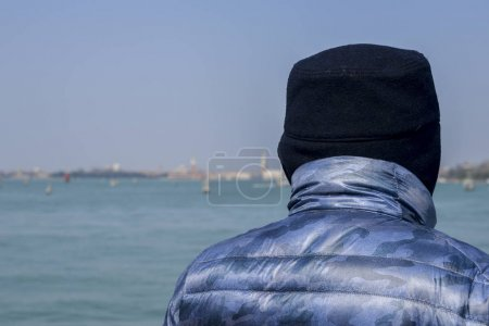Man on foreground of Venetian