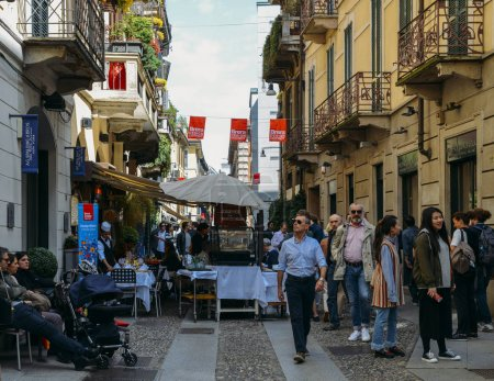 Tourists strolling in historic and bohemian Brera