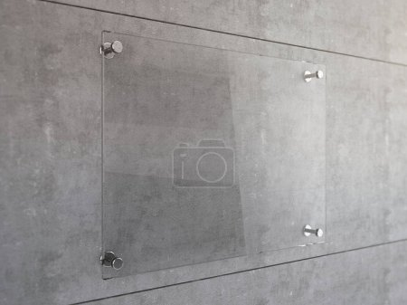 Mock Up of Transparent glass signboard with steel connectors on concrete wall