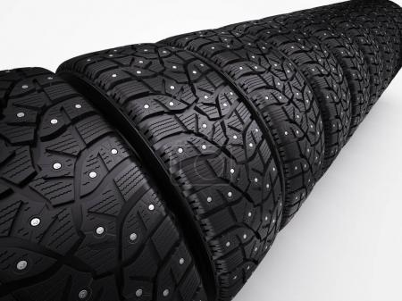 Winter snow tyres with metal spikes