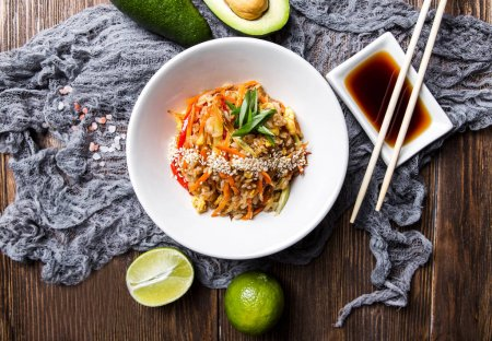 Japanese rice with vegetables on a dark wooden background top vi