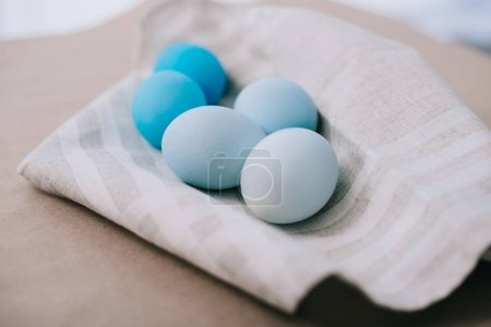 close-up shot of blue shades easter eggs on napkin
