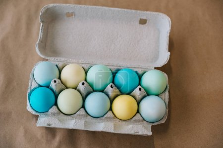 top view of colored easter eggs in cardboard pack
