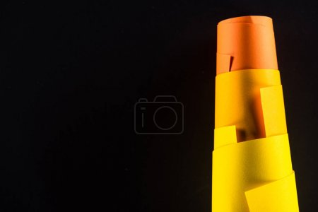colored rolled papers isolated on black for background