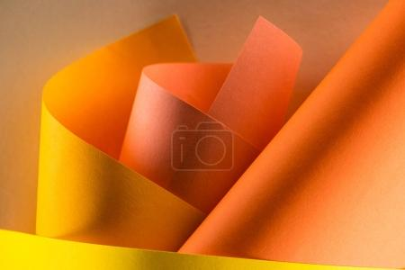 close-up shot of rolled orange and yellow colored papers for background