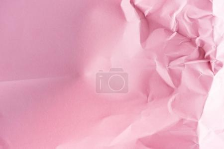 close-up shot of crumpled pink paper for background
