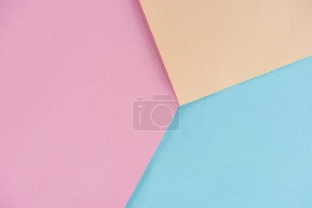 geometrical composition made of pastel colors papers