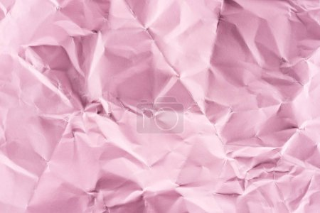 Photo for Close-up shot of crumpled pink paper for background - Royalty Free Image