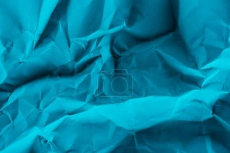 close-up shot of crumpled blue paper for background