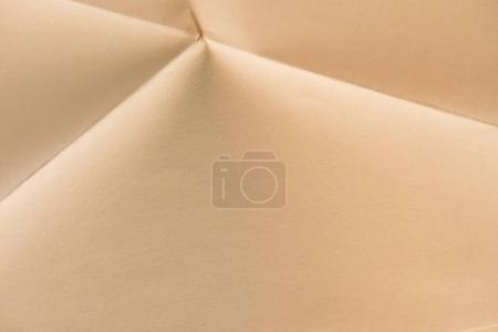 close-up shot of folded biege color paper