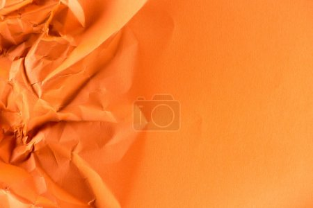 Photo for Close-up shot of orange crumpled paper for background - Royalty Free Image