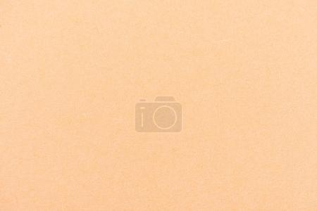 Photo for Texture of peach-yellow color paper as background - Royalty Free Image