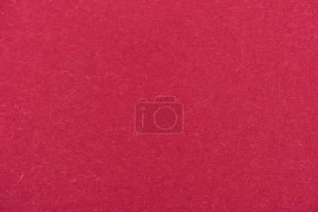 texture of maroon color paper as background